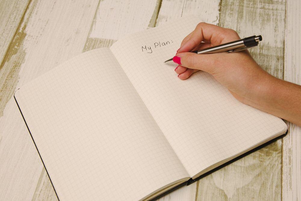 Ecrire ses objectifs dans un carnet.